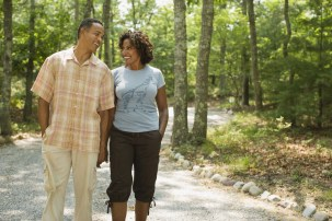 Couple holding hands and walking on path