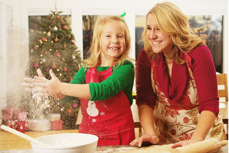 Mother and daughter making cookies