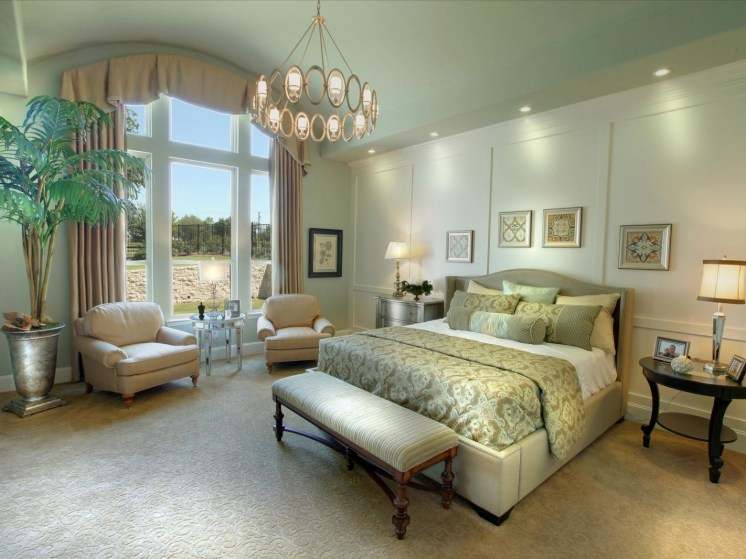 Green bedroom with textured carpeting