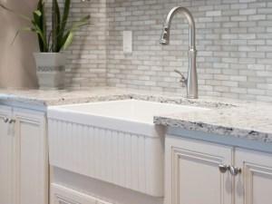 White farmhouse sink with decorative apron