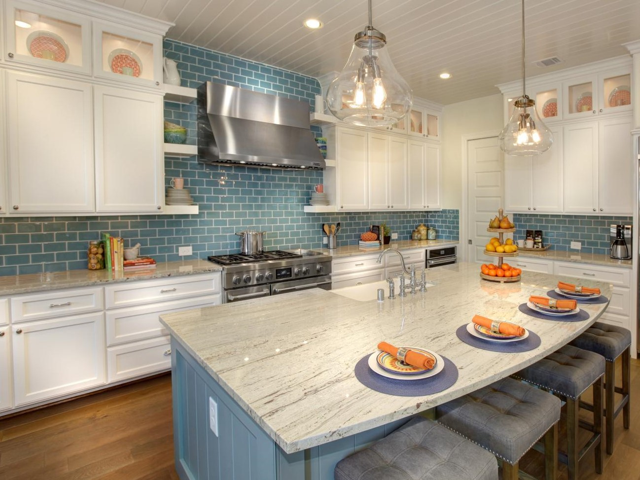 white kitchen cabinets with blue subway