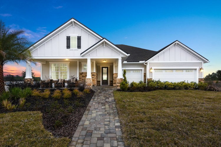The exterior of the Palmetto by Drees Homes, a ranch floor plan in Jacksonville, Florida.