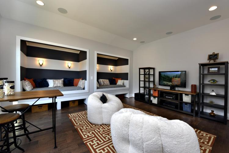 Bonus room featuring two built-in reading nooks by Drees Homes in Raleigh