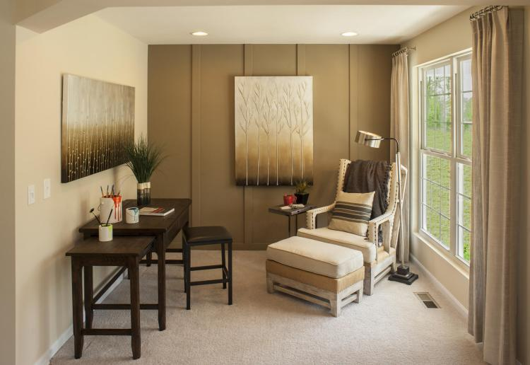Study featuring a statement wall in a Willow color