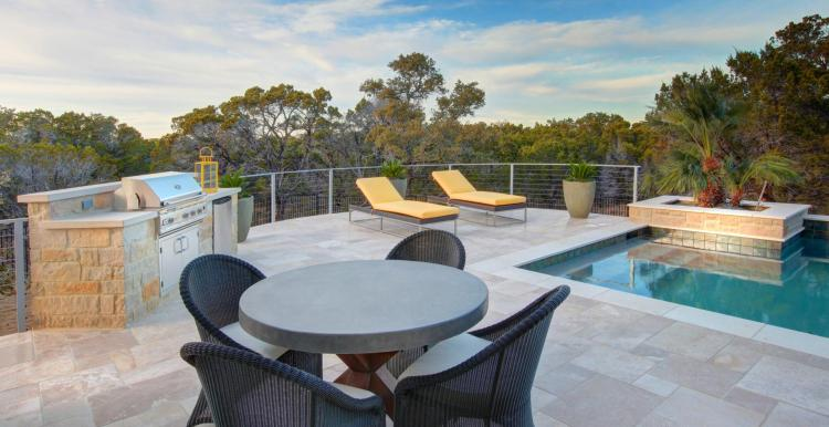 Built-in outdoor grill near swimming pool by Drees Custom Homes