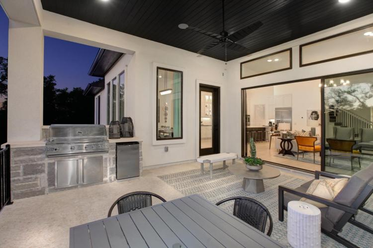 Outdoor kitchen with grill by Drees Custom Homes