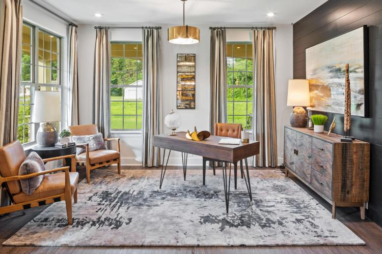 A study decorated in neutral, earth tones | By Drees Homes