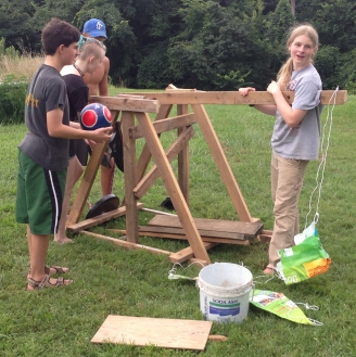 Homeschooled students building a trebuchet (click for credit)