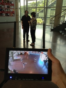Two users meeting in the third-person with the mobile device to show what they are seeing