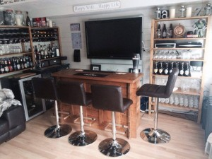 Log Cabin Transformations Cabin Bar with TV Dunster House