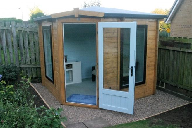 Coronet Log Cabin in the garden corner