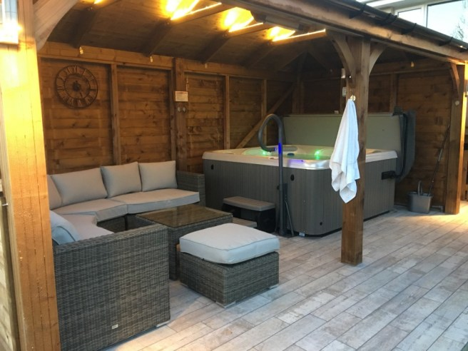 Customer Reviews: Atlas Gazebo from Dunster House with garden furniture and hot tub