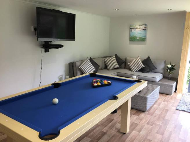 Garden Office with pool table and sofa