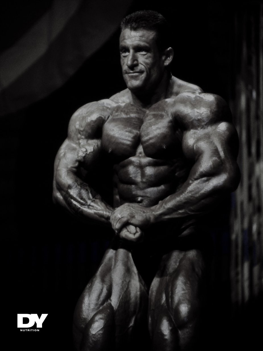 Dorian Yates posing with for front pecs in 1996. The mass monster was dominating the competition.