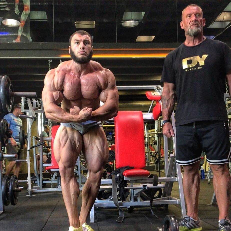 Dan Cristian posing after a training session with Dorian Yates