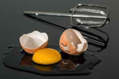 cracked open egg yolk