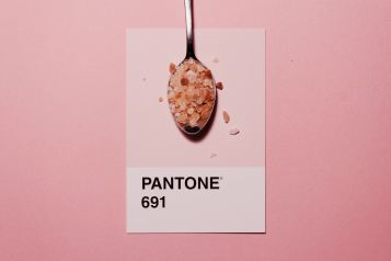 sugar in a spoon on pantone 691