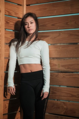 Christina Pazcoguin in white top and black pants