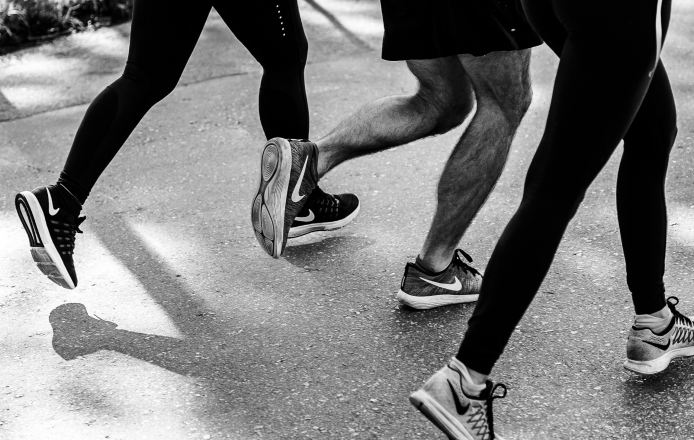black and white photo of runners outside