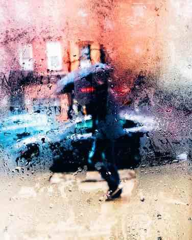 raining through window, person with umbrella