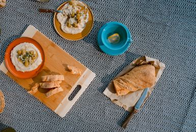 hummus and bread on a cutting board