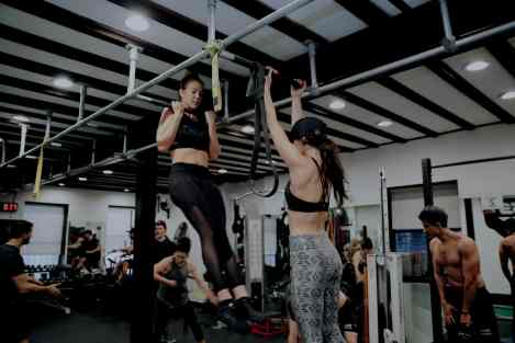 EBOOST female athletes performing chin ups