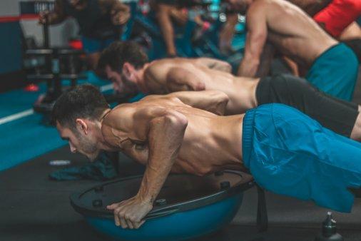 EBOOST Ambassador holiday fitness challenge push-up on a bosu ball