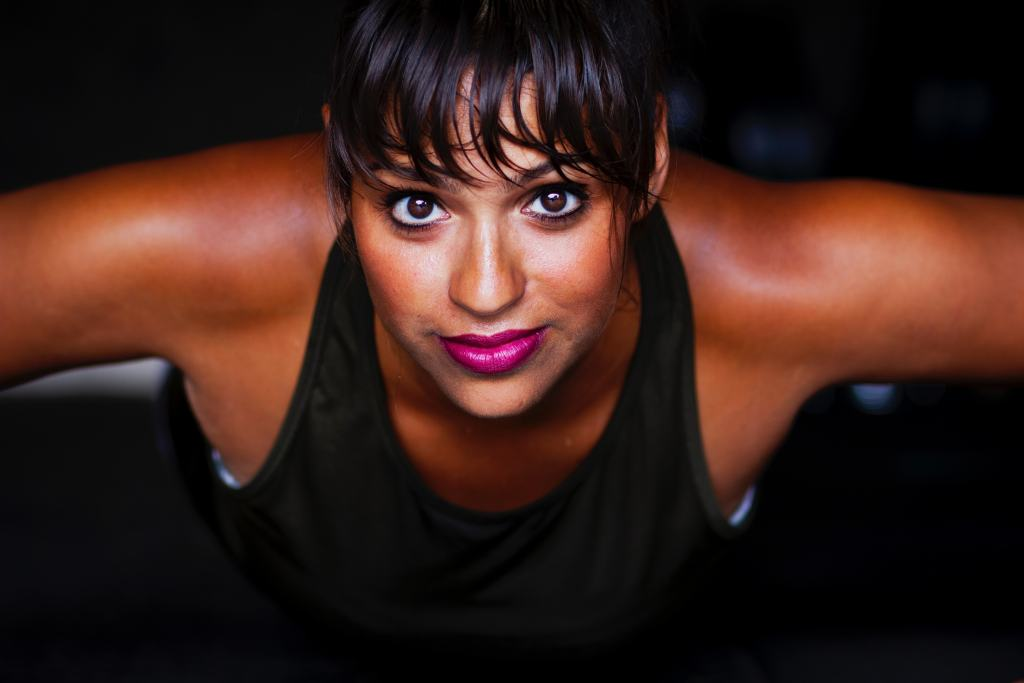 women in pushup position, black tank top, pink lips