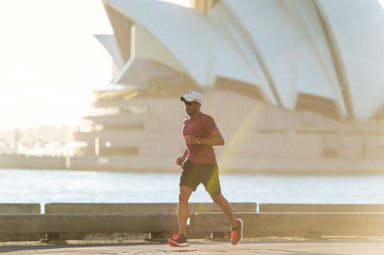 man running along the bay in Sydney