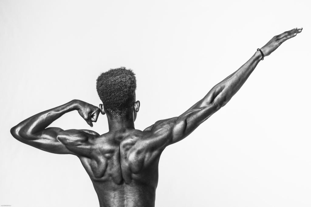 man with muscular shoulder and back