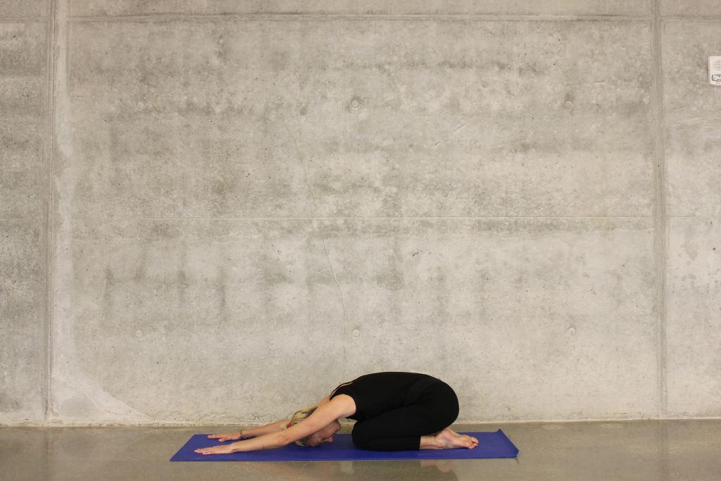 women yoga, child's pose