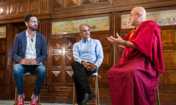 Guy Raz (left), Pico Iyer (center), and Matthieu Ricard (right) discuss mindfulness and the importance of being still at TED Global 2014. Photo by Duncan Davidson/TED.