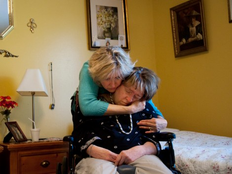 A Front Royal, Virginia, woman comforts her twin, who suffers from Alzheimer's. Photograph by Jodi Cobb, National Geographic