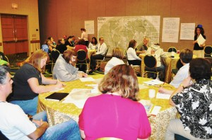 Attendees separate into groups to discuss and brainstorm.
