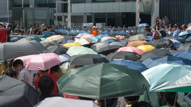 Unfurled umbrellas have become the symbol of the 2014 Hong Kong democracy protests. Photograph by Dr. Ho. This file is licensed under the Creative Commons Attribution ShareAlike 2.0 Generic license.