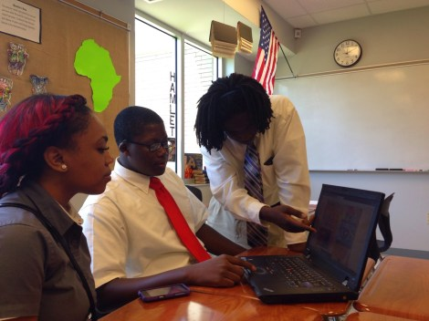 Aldrishon Jones, Dreydan Doss, and Cedtoria Moye collaborate on a digital poster during a project-based task in their AP Literature class at B.C. Rain High School in Mobile, Alabama. Photograph by Angela Crawford.