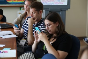 Steering Committee members trying our Gooru on their phones. Photograph by Tirzah Weiskotten.