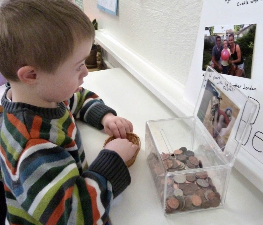 Photo of boy donating money