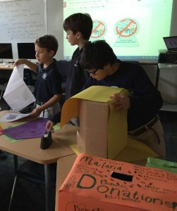 Boys making donation boxes