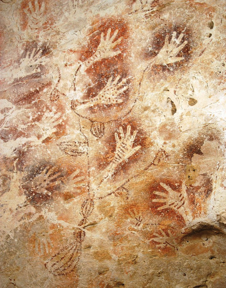 Ancient people of the island of Borneo made these impressions of their hands in cliffside caves 10,000 years ago. Photograph by Luc-Henri Fage, courtesy Wikimedia and Borneo, Memory of the Caves. Public domain.