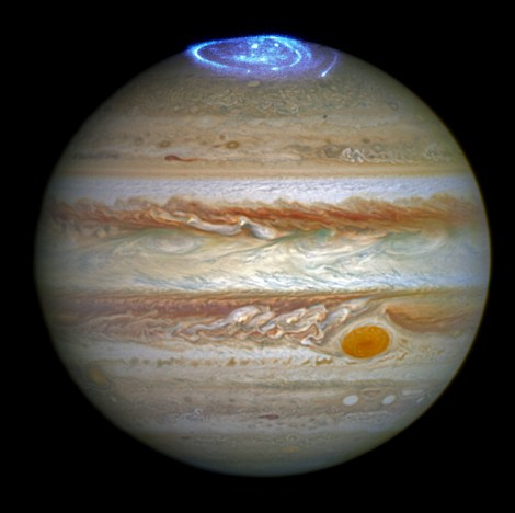 "Jupiter's auroras are ""like the Northern Lights on steroids,"" hundreds of times larger and more energetic than auroras on Earth. (This pretty picture is courtesy Hubble, not Juno quite yet.) Photograph courtesy NASA"