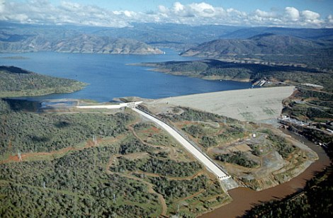 This is a great view of the entire Oroville Dam project. The dam itself is on the right, the main spillway (dry) is in the middle of the image, and the shrubland to the left is the dam's emergency spillway. Photograph by California Department of Water Resources