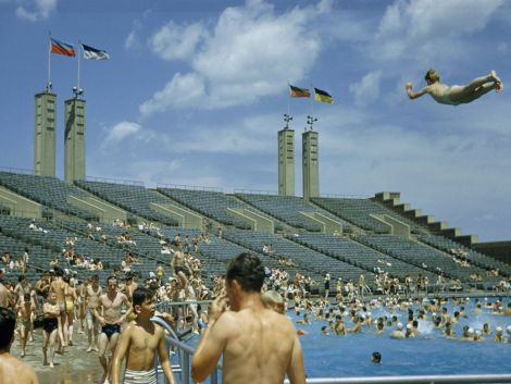 New Yorkers take a break from the summer heat in the pool at Flushing Meadows-Corona Park, Queens, in 1951. Photograph by Howell Walker, National Geographic