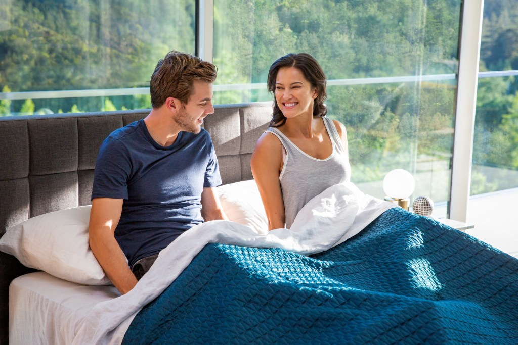 Couple on Eight Sleep Pod Pro in Morning