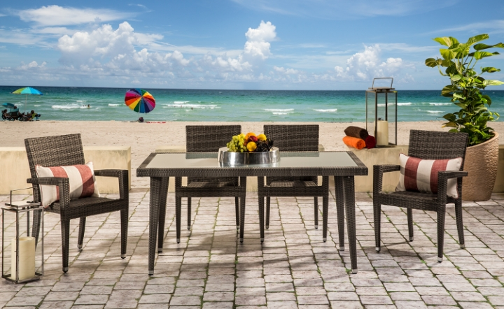 Brown dining table and brown dining chairs in an outdoor lifestyle setting by El Dorado Furniture