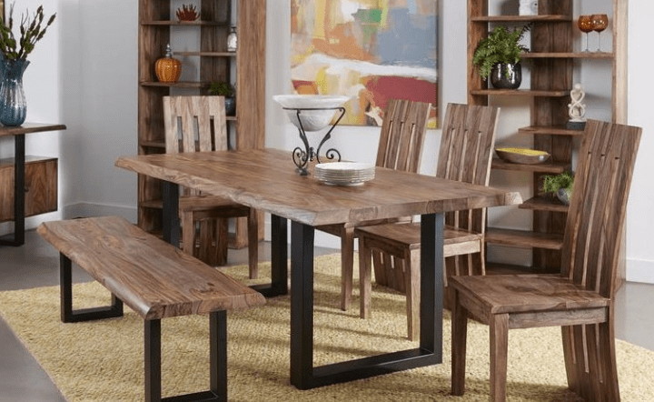 Brown bench, chairs, dining table, bookcases, credenza, and plants in lifestyle setting