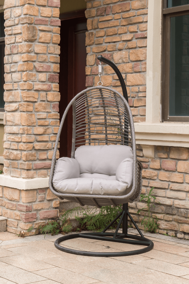 Basket hanging chair made from gray powder-coated durable flat PE wicker and polyester cushions.