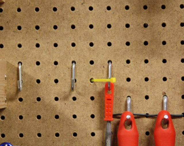 2- Poking the Zip Tie through the Pegboard