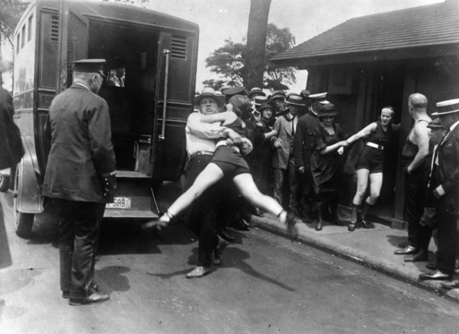 Women in Chicago being arrested for wearing one-piece bathing suits without the required leg coverings, in 1922.