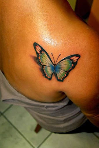 Colorful 3d butterfly tattoo designs for girls for their upper back.